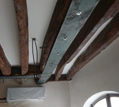 Logo Renforcement des poutres en bois existantes par fers plats – Paris